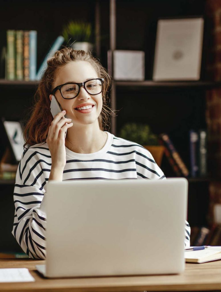 Image of girl working from home; managed IT services secure remote workstations.
